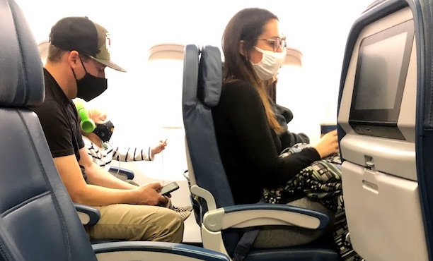 airline passengers wearing masks