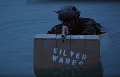 time warrior sniper rifle on box in water